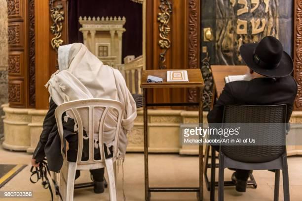 Israel, Jerusalem - 28 december 2017: Orthodox jewish men praying at the wailing wall - kotel