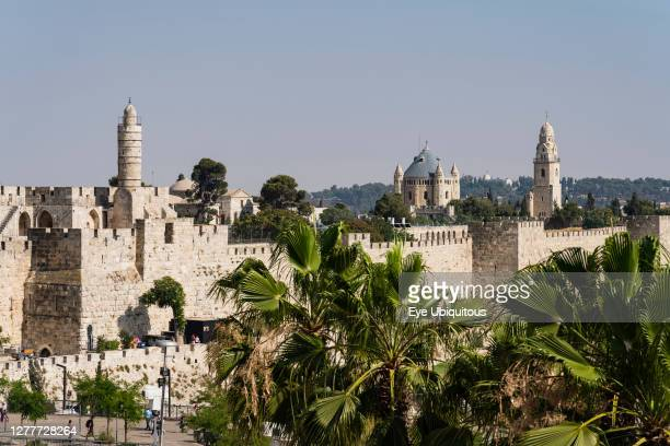 Israel, Jerusalem, Armenian Quarter, The city wall of Jerusalem with the minaret of the Tower of David or the Citadel in the foreground. Behind is...