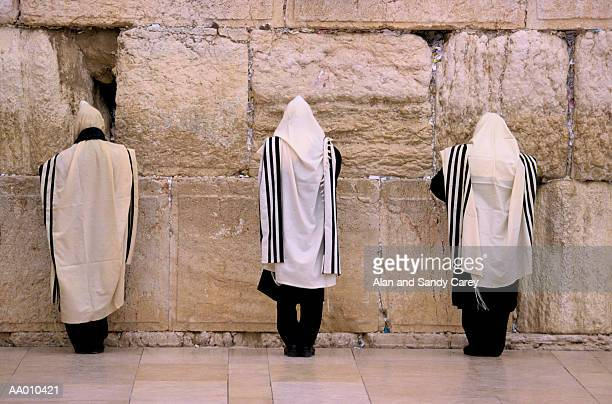 israel, jerusalem, men praying at western wall, rear view - place of worship stock pictures, royalty-free photos & images
