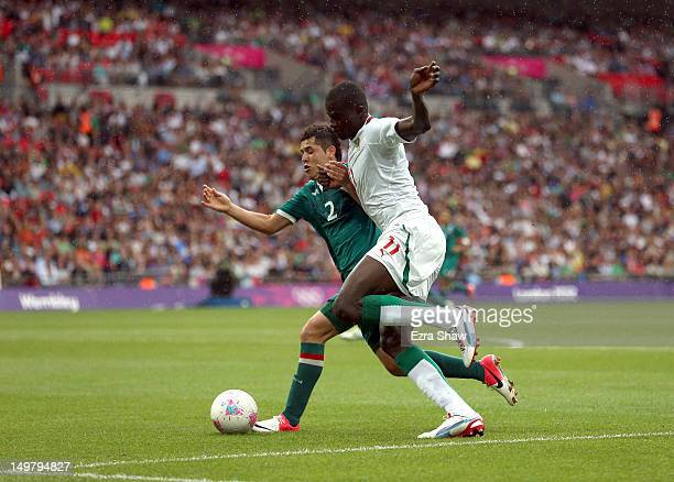 Israel Jimenez of Mexico and Kalidou Yero of Senegal go for the ball during the Men's Football Quarter Final match between Mexico and Senegal on Day...