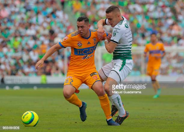 Israel Jimenez of Tigres and Jonathan Rodriguez of Santos fight for the ball during the quarter finals second leg match between Santos Laguna and...