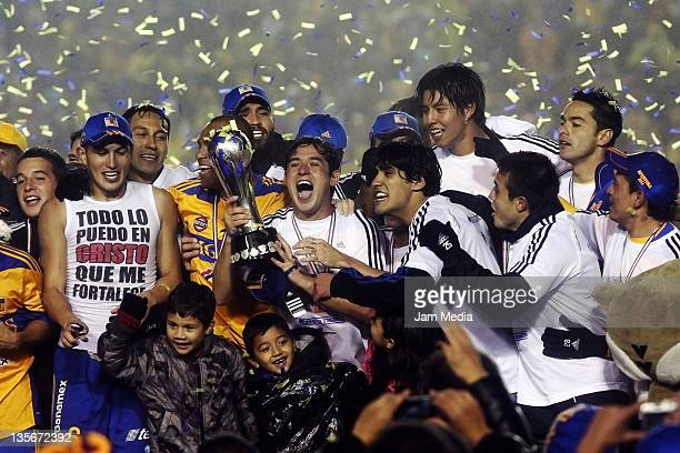 Israel Jimenez of Tigres celebrate championship title after defeating Santos in a final match as part of the Apertura Tournament 2011 at...