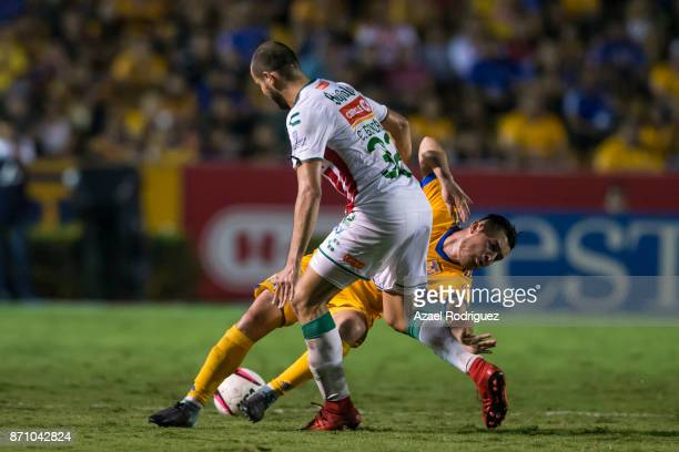 Israel Jimenez of Tigres fights for the ball with Carlos Gonzalez of Necaxa during the 16th round match between Tigres UANL and Necaxa as part of the...