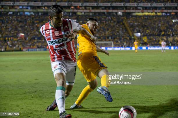 Israel Jimenez of Tigres fights for the ball with Miguel Angel Ponce of Necaxa during the 16th round match between Tigres UANL and Necaxa as part of...