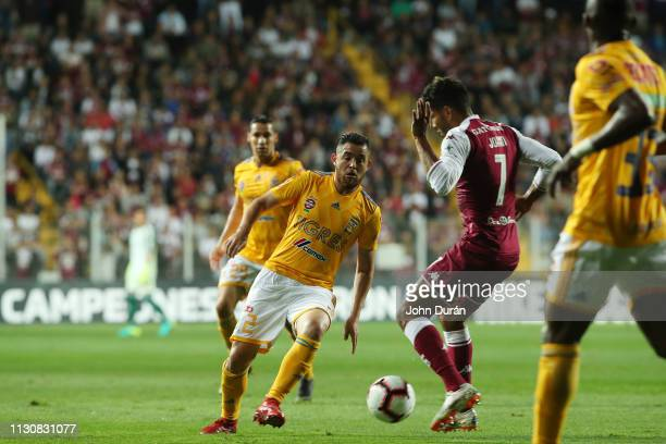 Israel Jimenez of Tigres UANL dominates the ball against the mark of the player Johan Venegas of Deportivo saprissa during the first leg of the...