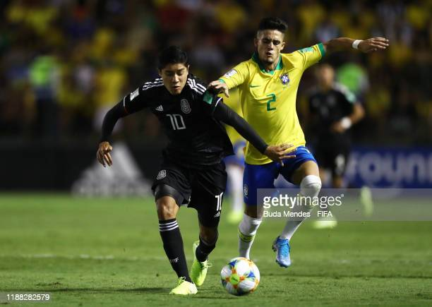 Israel Luna of Mexico looks to break past Yan Couto of Brazil during the Final of the FIFA U17 World Cup Brazil 2019 between Mexico and Brazil at the...
