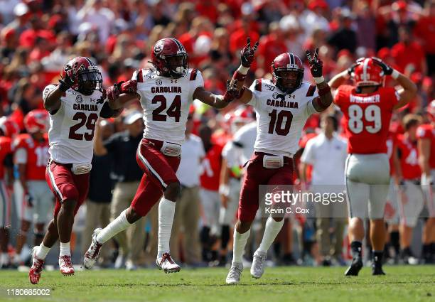 Israel Mukuamu of the South Carolina Gamecocks reacts after his second interception of the game against the Georgia Bulldogs in the second half of...