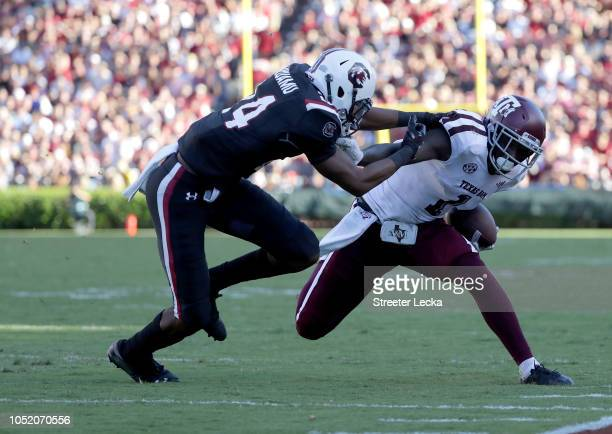 Israel Mukuamu of the South Carolina Gamecocks tries to stop Quartney Davis of the Texas AM Aggies during their game at WilliamsBrice Stadium on...