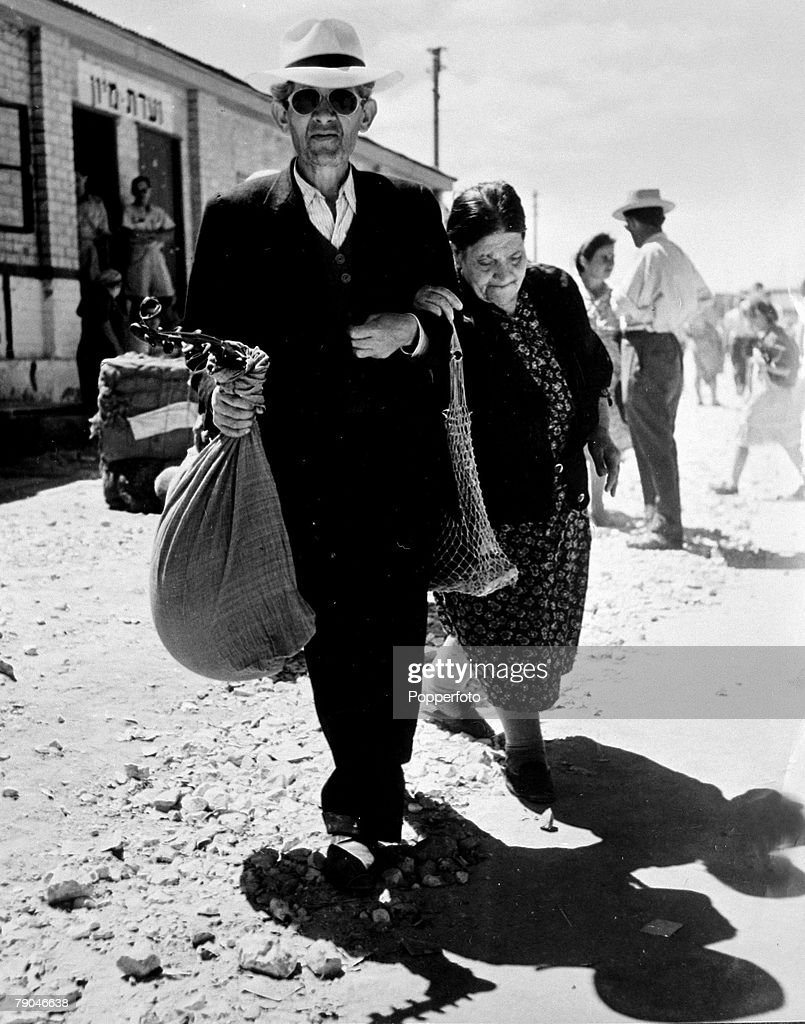 circa 1949, A common scene of the time showing a Jewish immigrants, an elderly couple, with their worldly possessions, about to start a new life in Israel, Mass immigration had resulted in Jews from post war Europe and Asia flooding into the newly formed state of Israel which had been formed in 1948