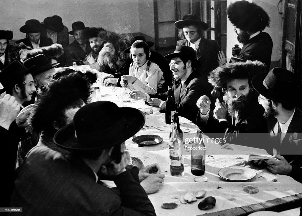 circa 1949, A scene of the time showing Jewish immigrants gathered around a table about to start a new life in Israel, Mass immigration had resulted in Jews from post war Europe and Asia flooding into the newly formed state of Israel which had been formed in 1948