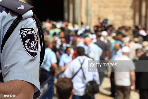 israel police officer in the crowded street - israel stock pictures, royalty-free photos & images