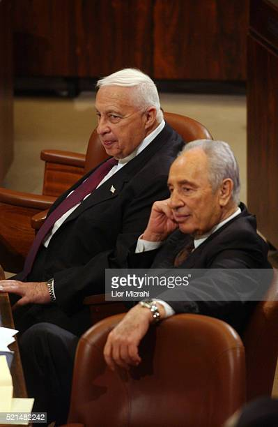 Israel Prime Minister Ariel Sharon and Vice Premier Shimon Peres are seen during the budget vote at the Knesset Israel's Parliament in Jerusalem on...