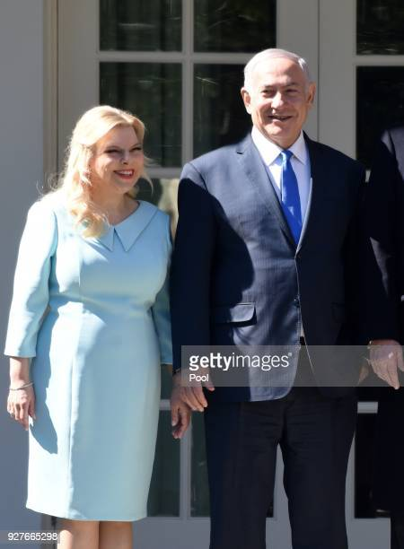 Israel Prime Minister Benjamin Netanyahu and Sara Netanyahu pose outside the Oval Office of the White House March 5, 2018 in Washington, DC. The...