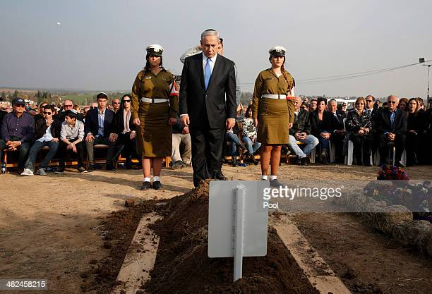 Israel Prime Minister Benjamin Netanyahu lays a wreath during the funeral of former Israeli Prime Minister Ariel Sharon at Sycamore Farm on January...