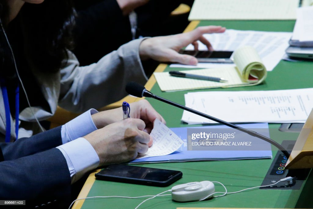 Israel representative to the United Nations, Danny Danon, checks his list of voters after voting on Jerusalem, on December 21, 2017, at UN Headquarters in New York. UN member-states were poised to vote on a motion rejecting US recognition of Jerusalem as Israel's capital, after President Donald Trump threatened to cut funding to countries that back the measure. /