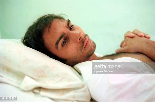 Israel Roja Gonzalez an HIV positive patient rests in bed inside the staterun AIDS sanitorium in Havana Cuba on April 28 2001 The Cuban government...
