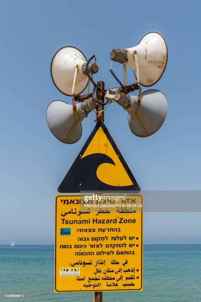 tsunami hazard zone sign at the news photo