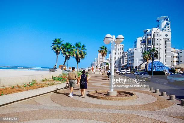 israel, tel aviv, people walking on the roadside - tel aviv stock photos and pictures