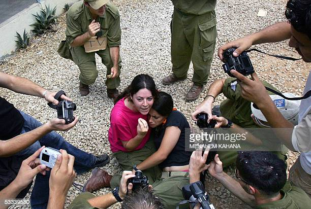 Two women soldiers acting as resisting settlers are surrounded by journalists during an Israeli policemen training to evacuate them from their homes...