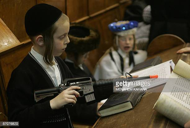 Ultra Orthodox Jews from the Wiznitz Hassidim group reads the Ester scrolls at the synagogue in the Israeli town of Beni Brak near Tel Aviv 13 March...