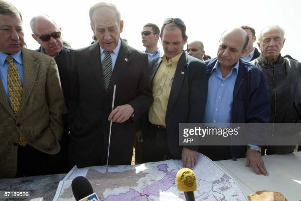 Israeli acting Prime Minister Ehud Olmert Defence Minister Shaul Mofaz and former premier Shimon Peres look at a map during a visit in to the Israeli...