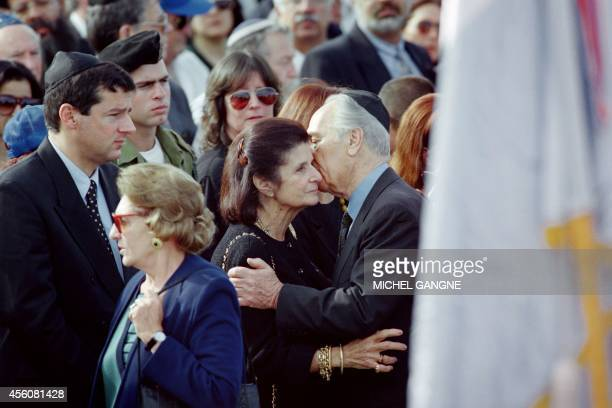 Israeli acting Prime Minister Shimon peres comforts Lea Rabin widow of Israeli Prime Minister Yitzhak Rabin during the Israeli leader's funeral at...