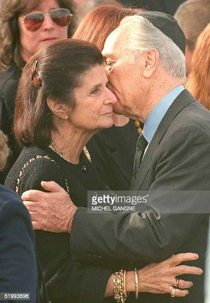 Israeli acting Prime Minister Shimon Peres comforts Mrs. Leah Rabin, widow of Israeli Prime Minister Yitzhak Rabin, during the Israeli leader's...