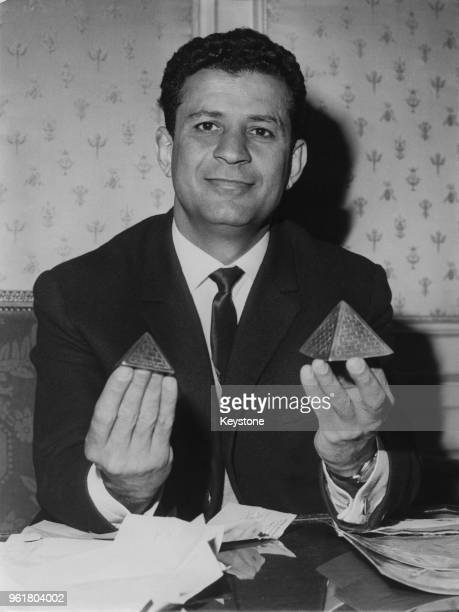 Israeli activist Abie Nathan at his hotel in Paris, France, with two miniature pyramids which he received as a gift in Port Said, 18th March 1966. He...