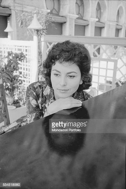 Israeli actress Haya Harareet leaning against a piece of furniture during the 19th Venice International Film Festival Venice August 1958