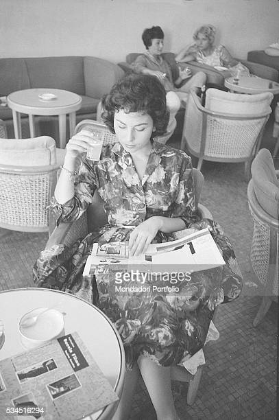 Israeli actress Haya Harareet sitting in a café and reading a magazine during the 19th Venice International Film Festival Venice August 1958
