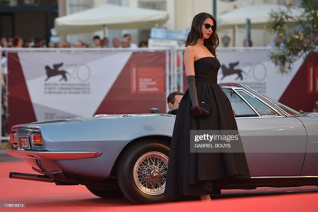 Israeli actress Moran Atias arrives for the opening ceremony of the 70th Venice Film Festival and the screening of the movie 'Gravity' presented out of competition, on August 28, 2013 at Venice Lido. The Venice film festival kicks off today with the arrival of movie stars on water taxis for a dark line-up flush with fiendish tales of abuse, betrayal and survival. The world's oldest film festival opens with 'Gravity', a 3-D sci-fi thriller starring George Clooney and Sandra Bullock as astronauts who are flung into deep space when a debris shower destroys their shuttle.