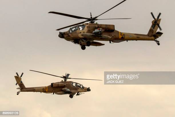 Israeli AH64 Apache longbow helicopters perform during an air show at the graduation ceremony of Israeli air force pilots at the Hatzerim Israeli Air...