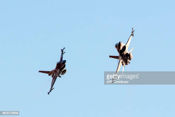 Israeli Air Force F16 Fighting Falcon fighter planes perform at an air show during the graduation of new cadet pilots at Hatzerim base in the Negev...