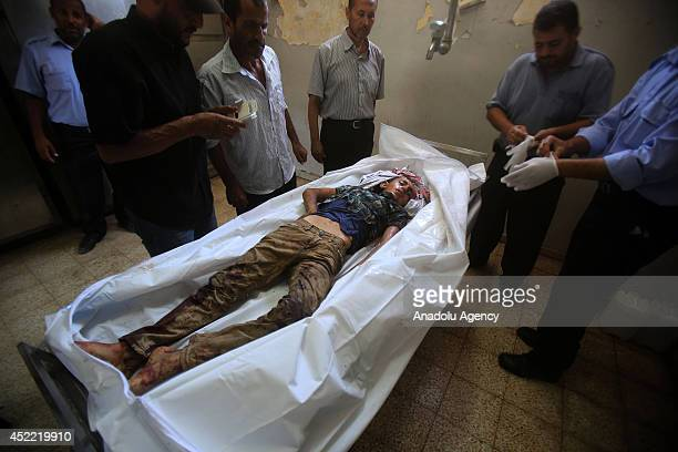 Israeli airstrikes to a car kill 3 people one was 10yearold Palestinian boy Ramadan Abudakha is seen in mortuary in Khan Yunis Gaza on 16 July 2014...