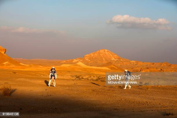 TOPSHOT Israeli analog astronauts start their mission on the DMARS Project on February 18 in cooperation with the Israel Space Agency which simulates...