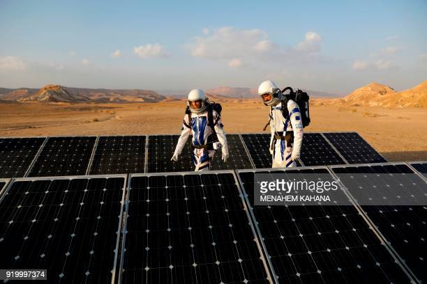 Israeli analog astronauts walk pat solar panels as they start their mission on the DMARS Project on February 18 in cooperation with the Israel Space...
