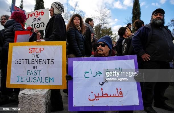 Israeli and foreigner peace activists stage a protest against Israeli authorities' decision on evacuating Palestinian families those who live in...