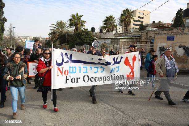 Israeli and foreigner peace activists stage a protest against Israeli authorities' decision on evacuating Palestinian families who live in Sheikh...
