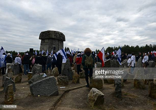 Israeli and Polish youth gather in front of the monument of Treblinka World War IIera Nazi death camp on October 2 2013 in Treblinka Around 600 young...