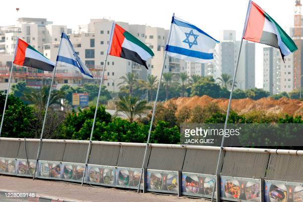 Israeli and United Arab Emirates flags line a road in the Israeli coastal city of Netanya on August 16 2020