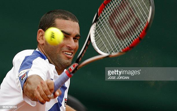 Israeli Andy Ram returns the ball against Spain's David Ferrer during the fourth match of the Davis cup semifinal between Spain and Israel at the...