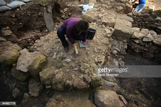 Israeli Antiquities Authority workers clear debris as an excavation reveals for the first time a Jesusera house from the Jewish village of Nazareth...
