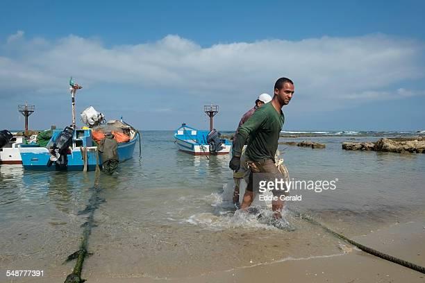 Israeli Arab fishermen returning from the morning fishing at the seacoast of the Israeli Arab town of Jisr az Zarqa or Gisr a Zarka in Israel