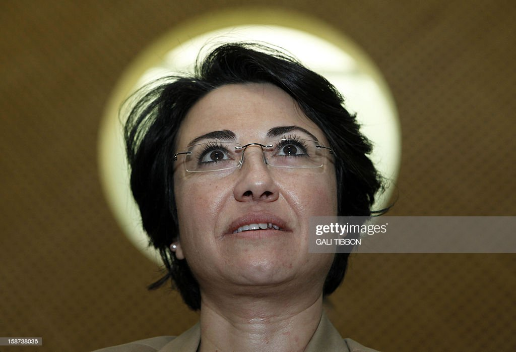 Israeli Arab Knesset (parliament) member Hanin Zuabi looks on as she arrives to the Supreme Court in Jerusalem on December 27, 2012, for a hearing regarding the Election Committee's decision to disqualify her from contending in the upcoming elections. AFP PHOTO