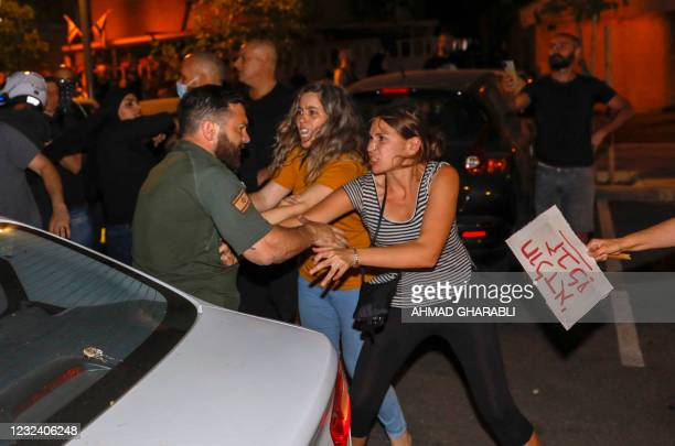 Israeli Arabs and Israeli left wing protesters hold a demonstration against the purchases of houses in Jaffa, near Tel Aviv, on April 19, 2021. -...