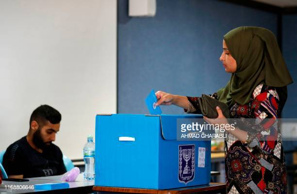 Israeli Arabs vote during Israel's parliamentary election at a polling station in Kafr Manda near Haifa on September 17 2019