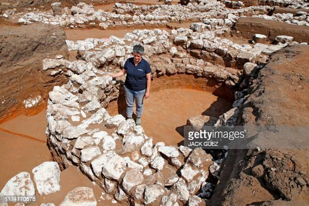 Israeli archaeologist Dina Shalem walks among stone structures at the archaeological site of En Esur where a 5000yearold city was uncovered near the...