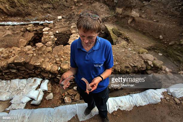 Israeli archaeologist Yardenna Alexandre inspects Roman 1st century AD pottery found in an excavation which reveals for the first time a Jesusera...