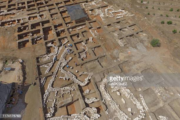 Israeli archaeologists work at the ancient site of En Esur where a 5000yearold city was uncovered near the Israeli town of Harish on October 06 2019...