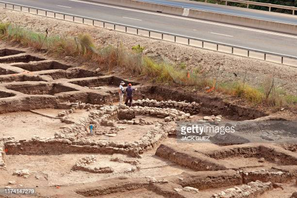 Israeli archaeologists work at the archaeological site of En Esur where a 5000yearold city was uncovered near the Israeli town of Harish on October...